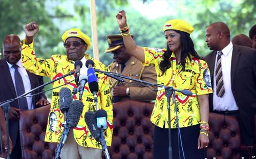 претседателот на Зимбабве Роберт Мугабе и неговата сопругаа
