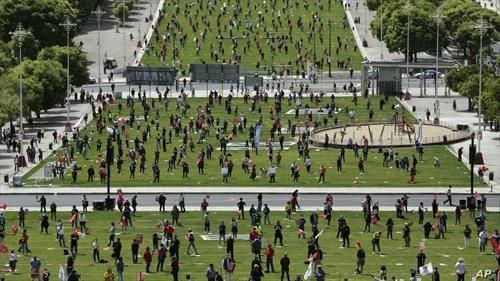 прво мајски протест во Лисабон