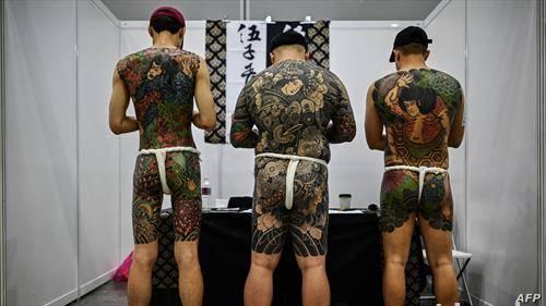 тетовирани Малезијци на саем во Куала Лумпур